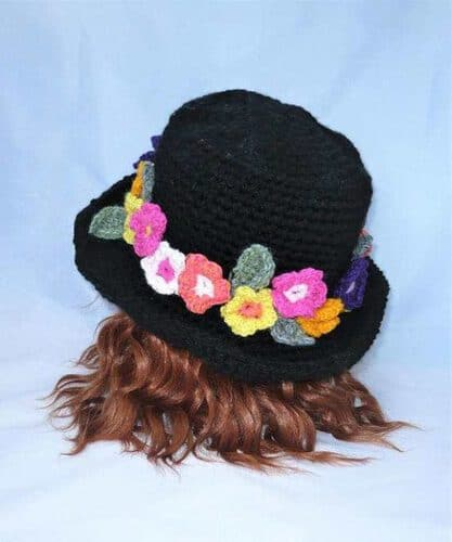 Hat: Black Woolly Hat with a Brimful of flowers. Crocheted. Handmade in the UK